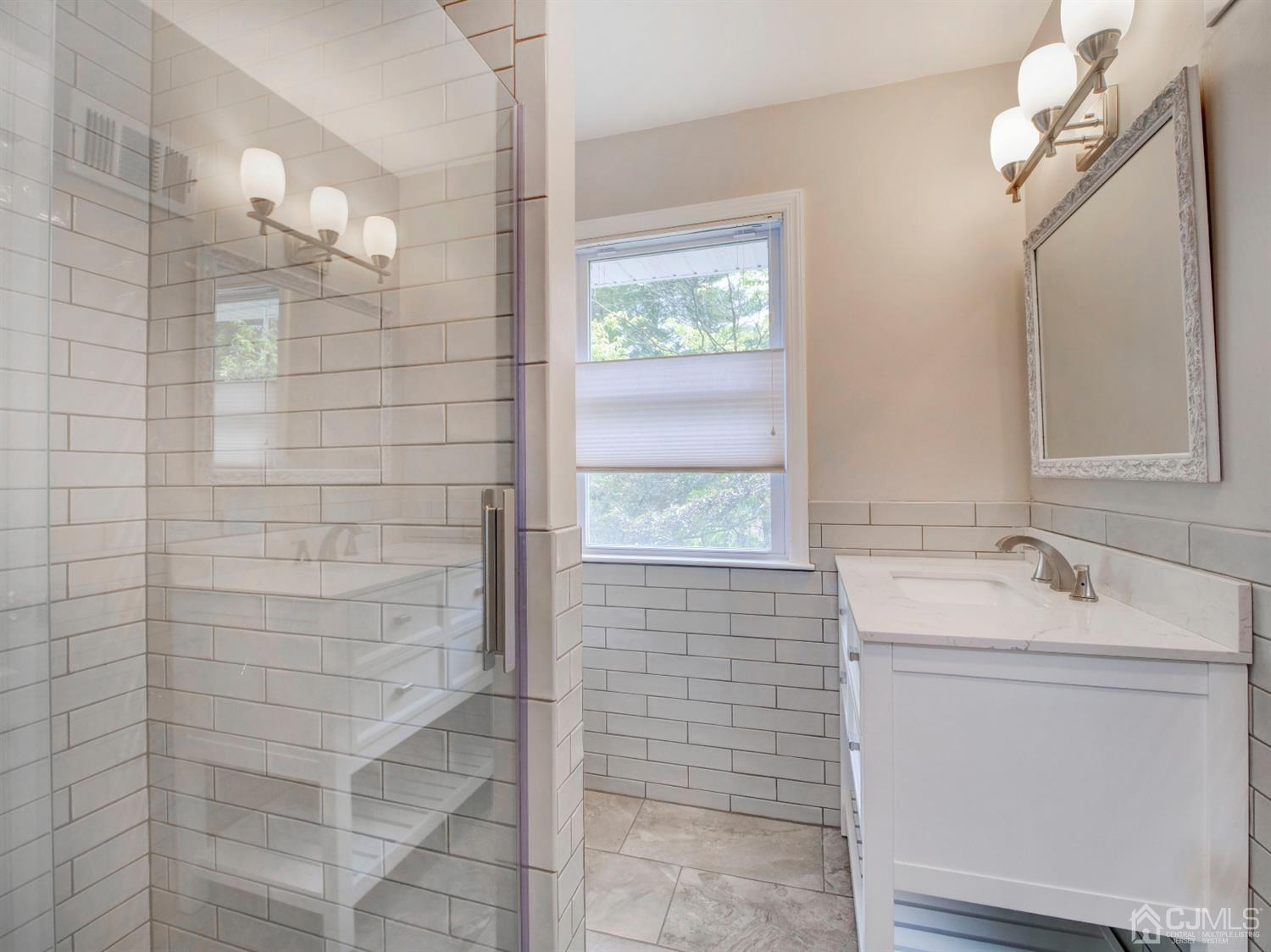 Master bath. Shower with pebble base and dual shower heads.