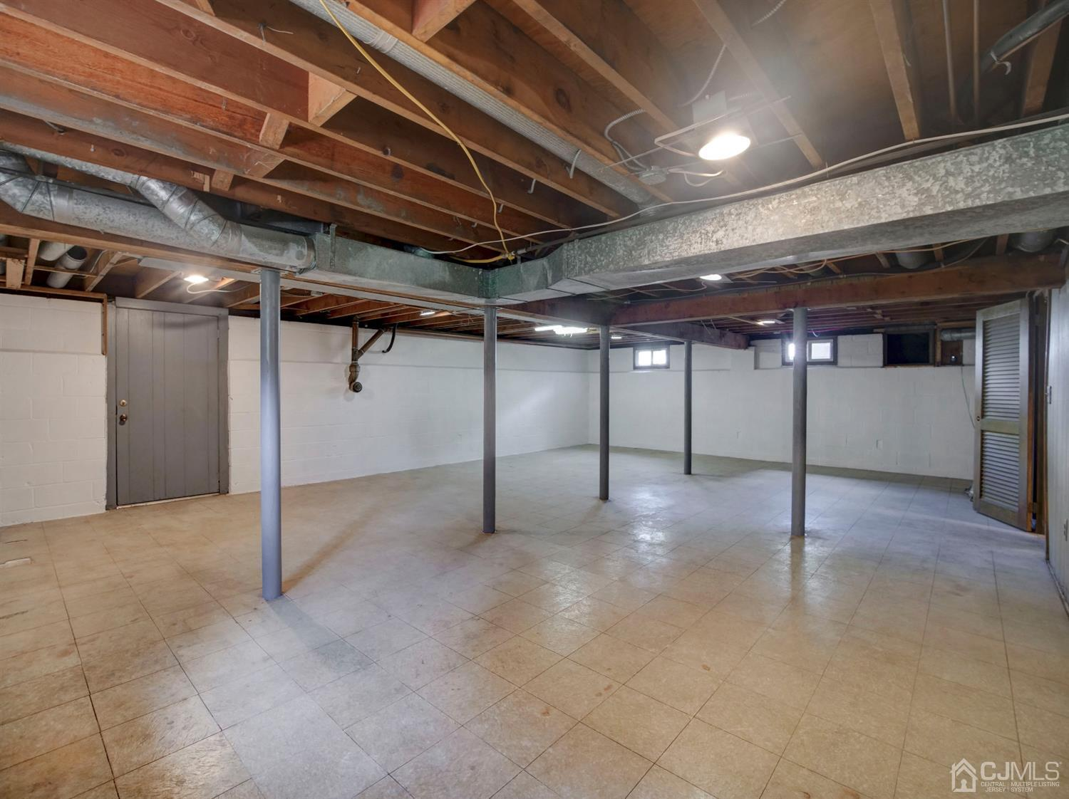 Full huge basement with outside access. This picture shows only about 60% of the basement area.  Basement has a older fully func