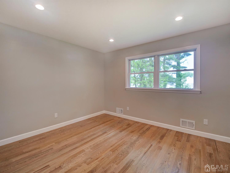 5th bedroom on 1st floor with walk-in closet