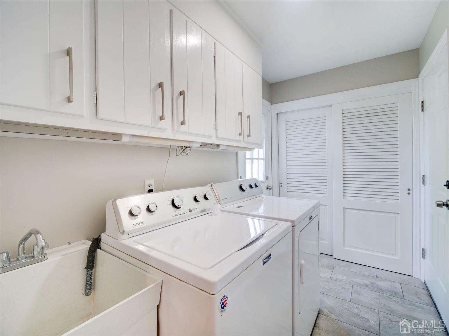 Laundry/ mud room of the kitchen with garage and back yard access and lot of extra closet and storage/panty space.
