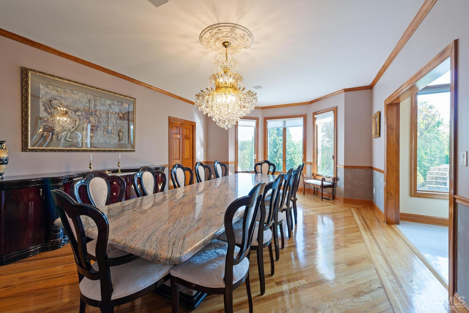 The Formal Dining Room is ready to entertain. This custom made Dining Set is included in the sale!