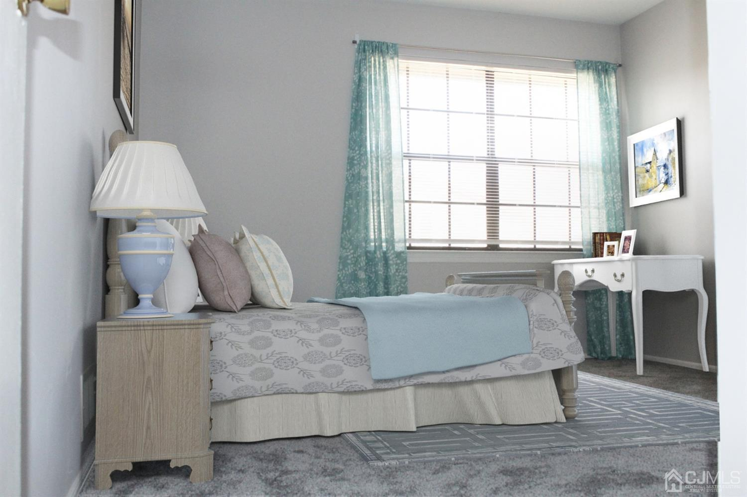 VIRTUAL STAGED WITH FURNITURE IN 2ND BEDROOM.