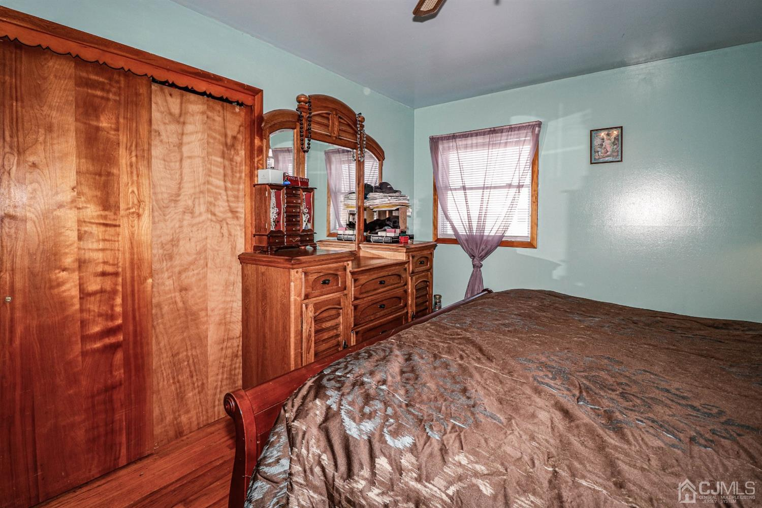 Two large double closets with plenty of room for triple dresser.