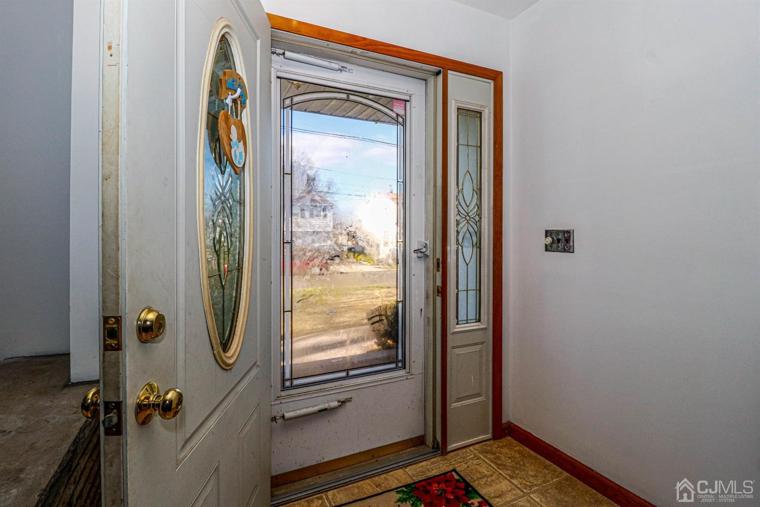 Front entrance into the foyer of this roomy ranch.