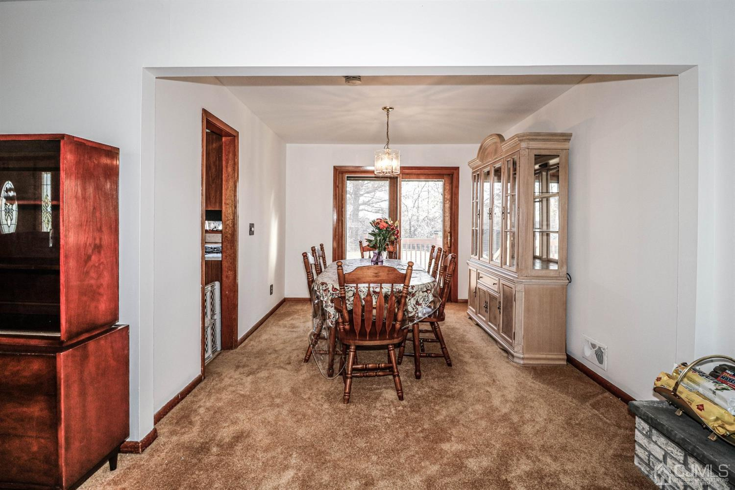 The Pella slider adds to the charm of the freshly painted dining room area bringing lots of natural light into the room.