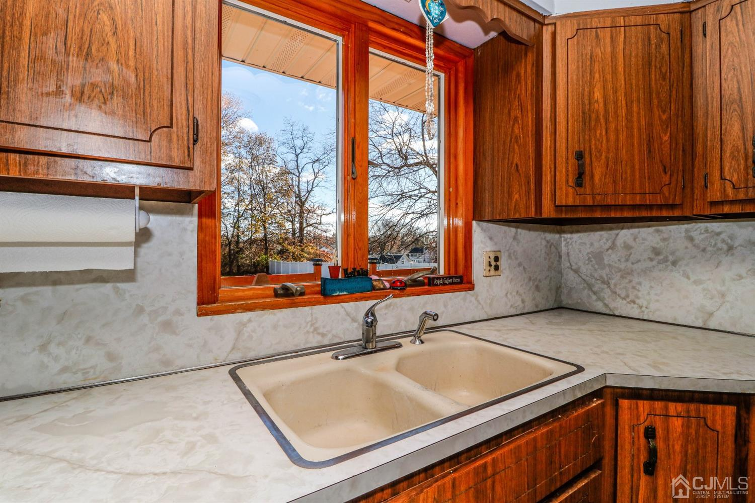 Enjoy the 4 season gorgeous views of the park like yard through these upgraded windows above the double porcelain sink.