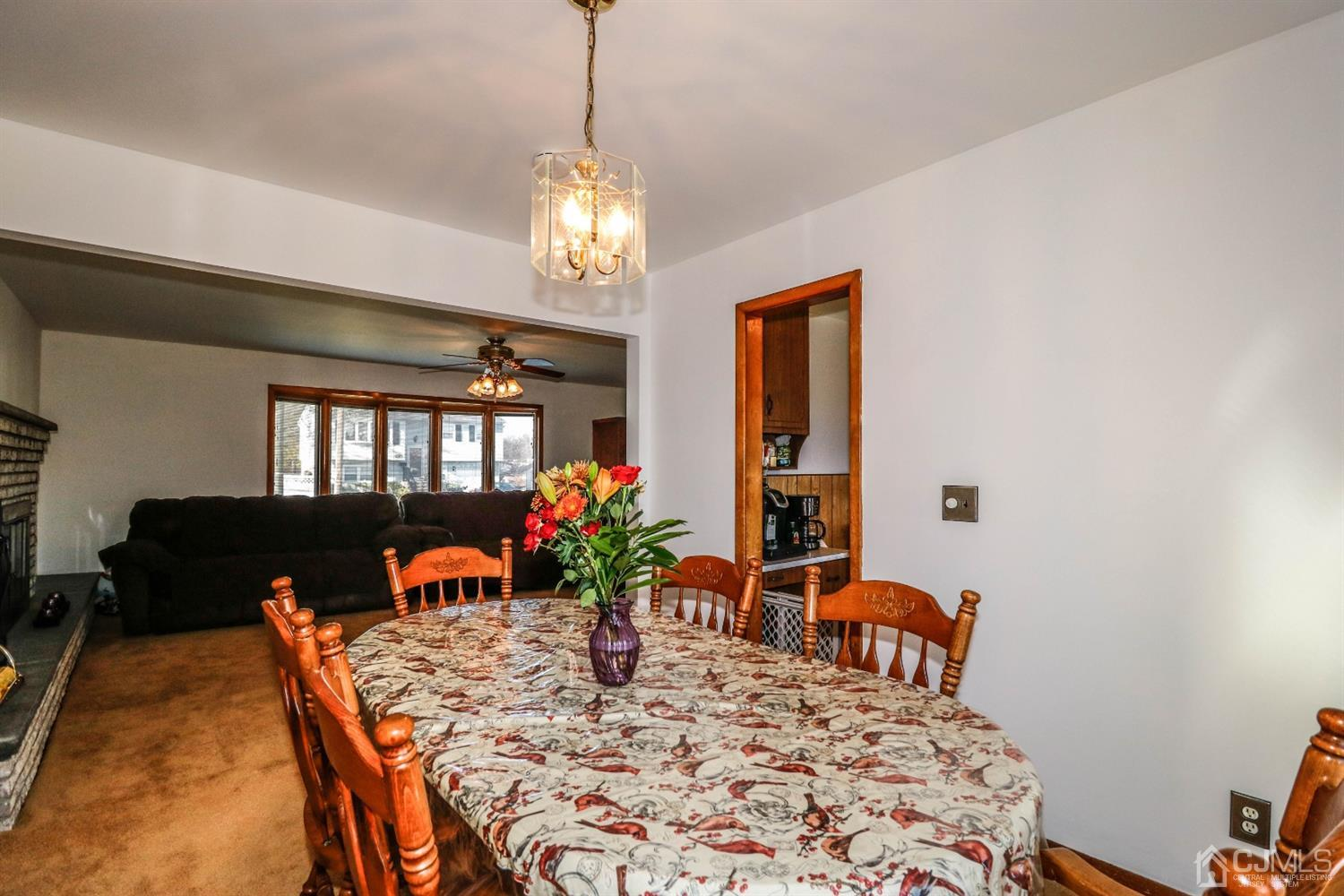 The elegant Formal Dining room flows from the Living room providing plenty of room to entertain guests.