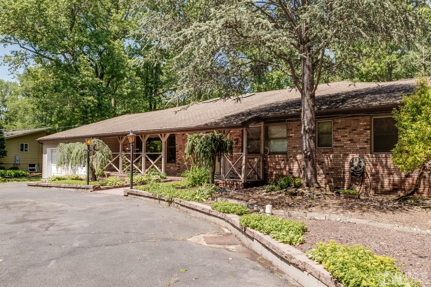 Custom sprawling Ranch with circular drive and plenty of parking.
