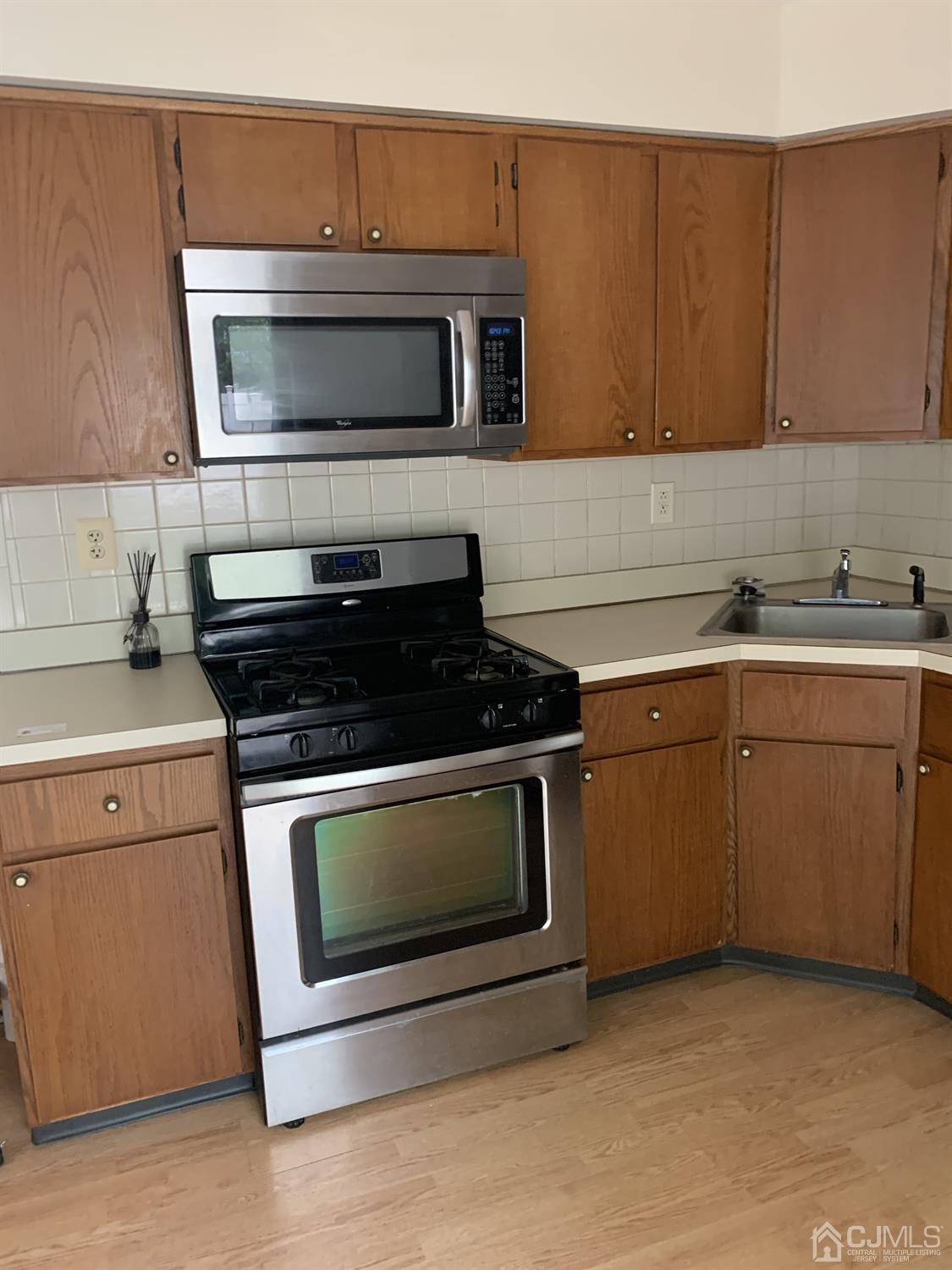 Kitchen stove and empty counters