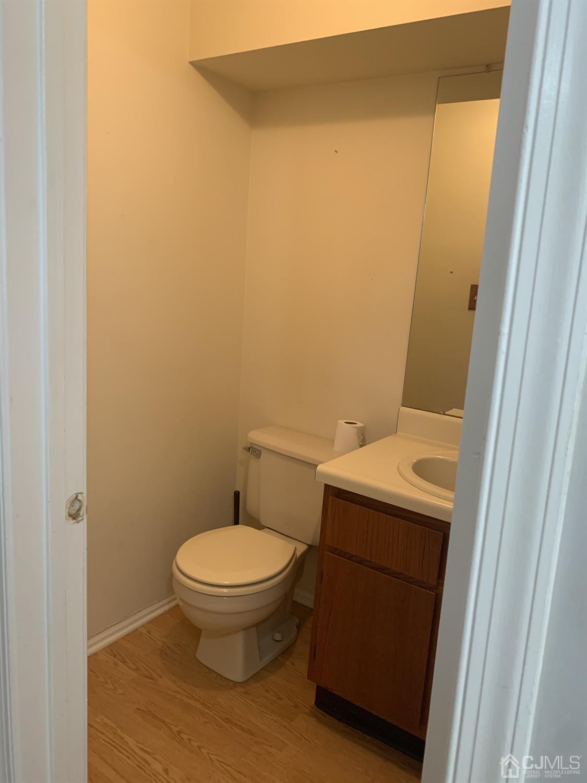 Half bath opposite front door w hall closet