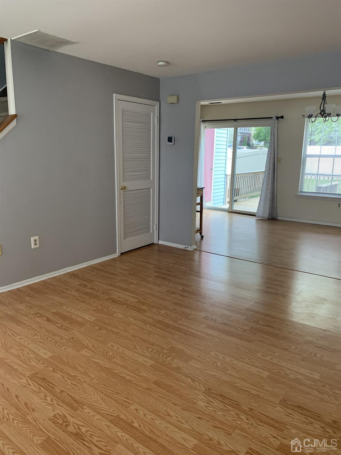 Living room laundry door to dining space from opposite side