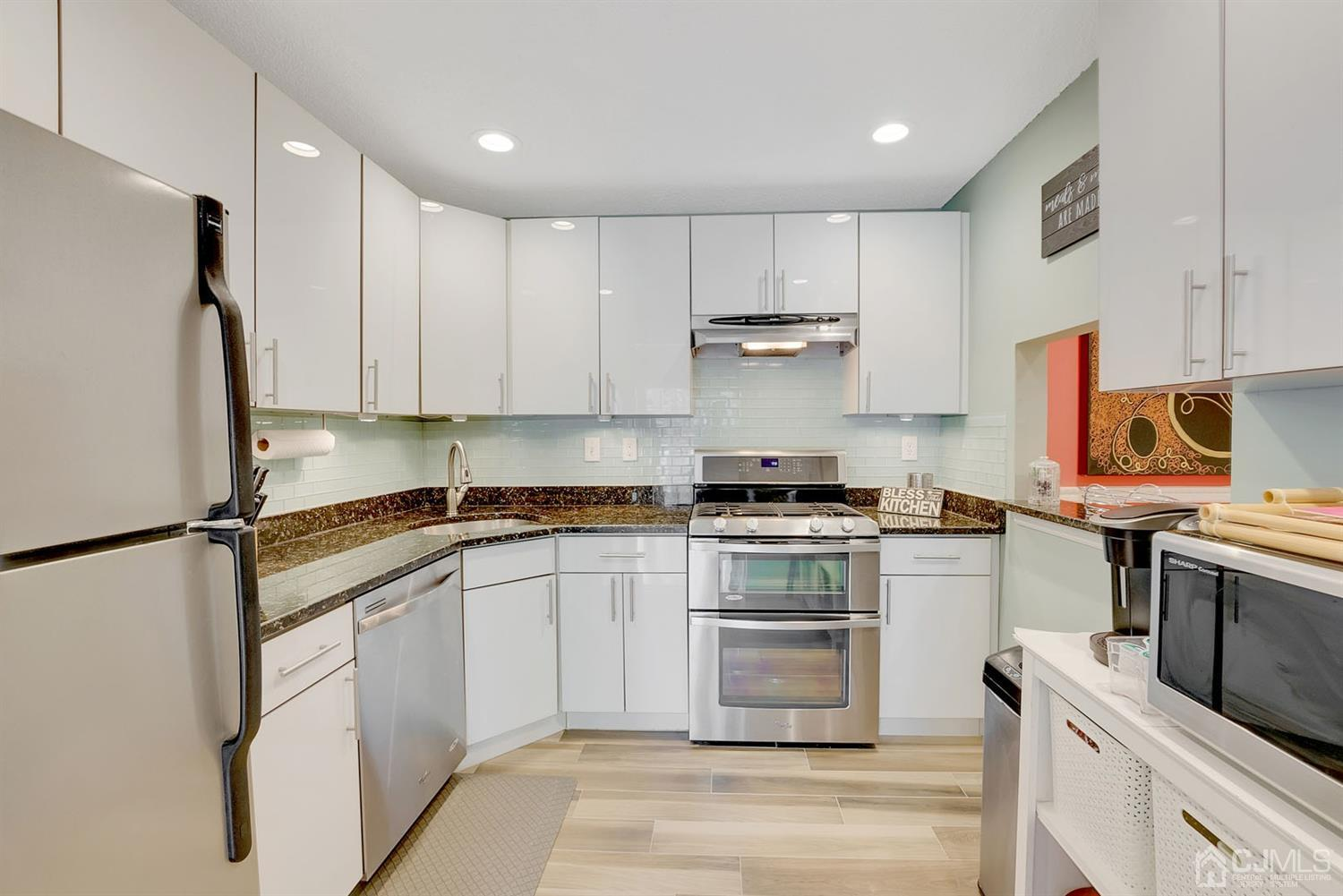 Updated kitchen with plenty of cabinets space.