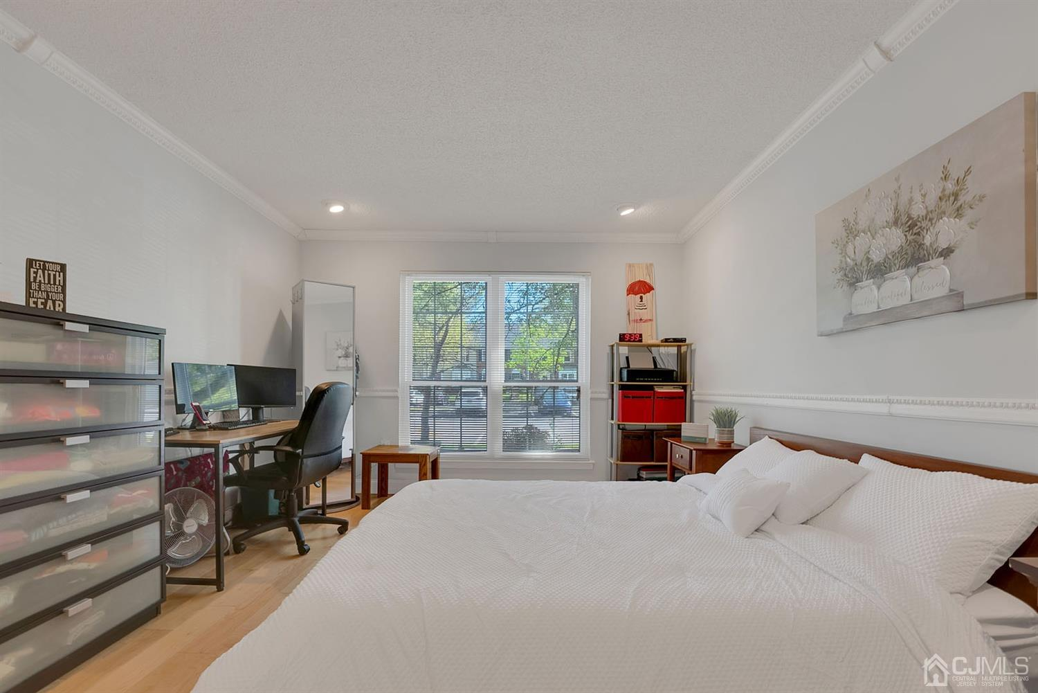Spacious Master bedroom with recessed lights, lots of closet space plus a separate linen closet and updated full bath with stall