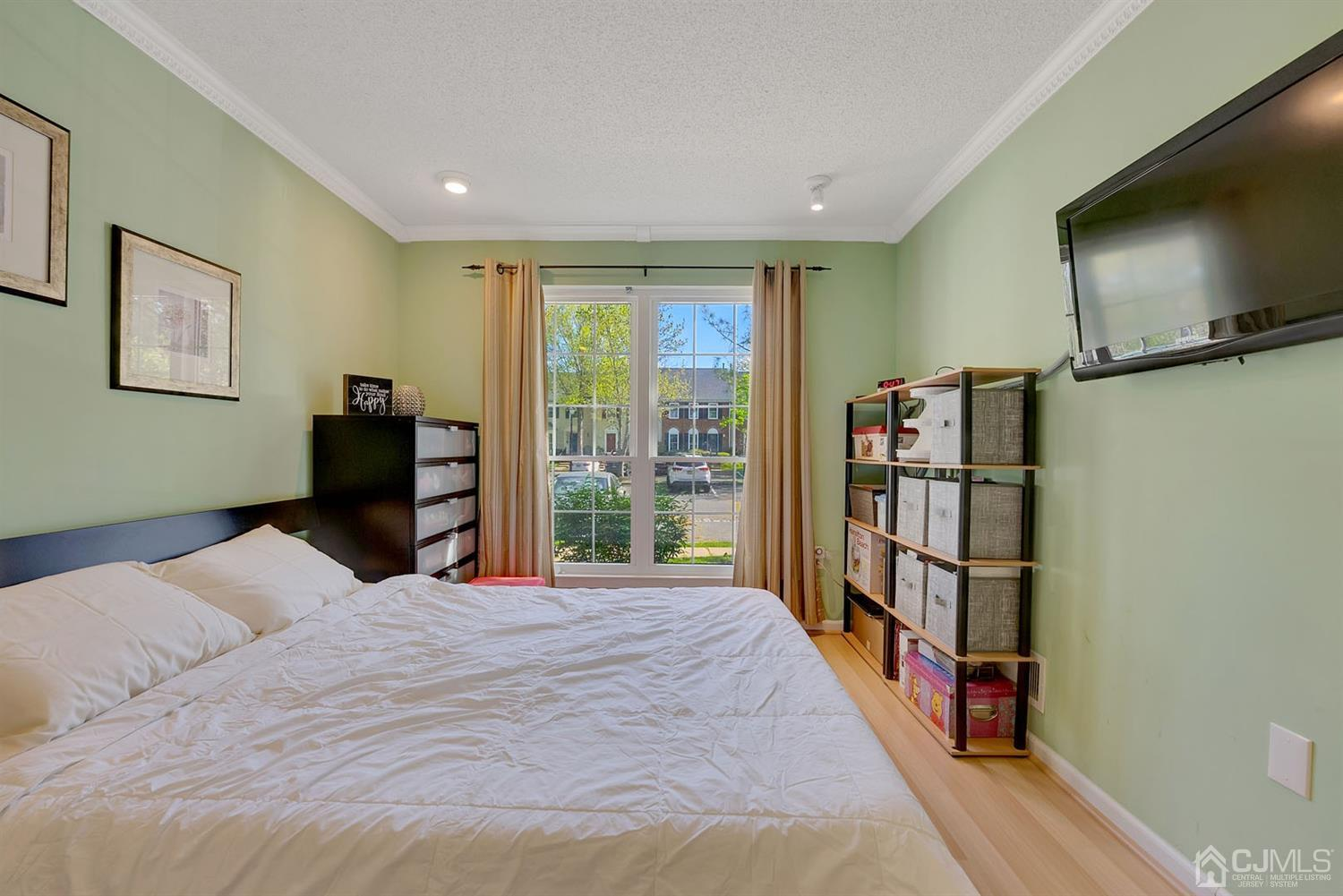 2nd bedroom with laminate floors and recessed lights