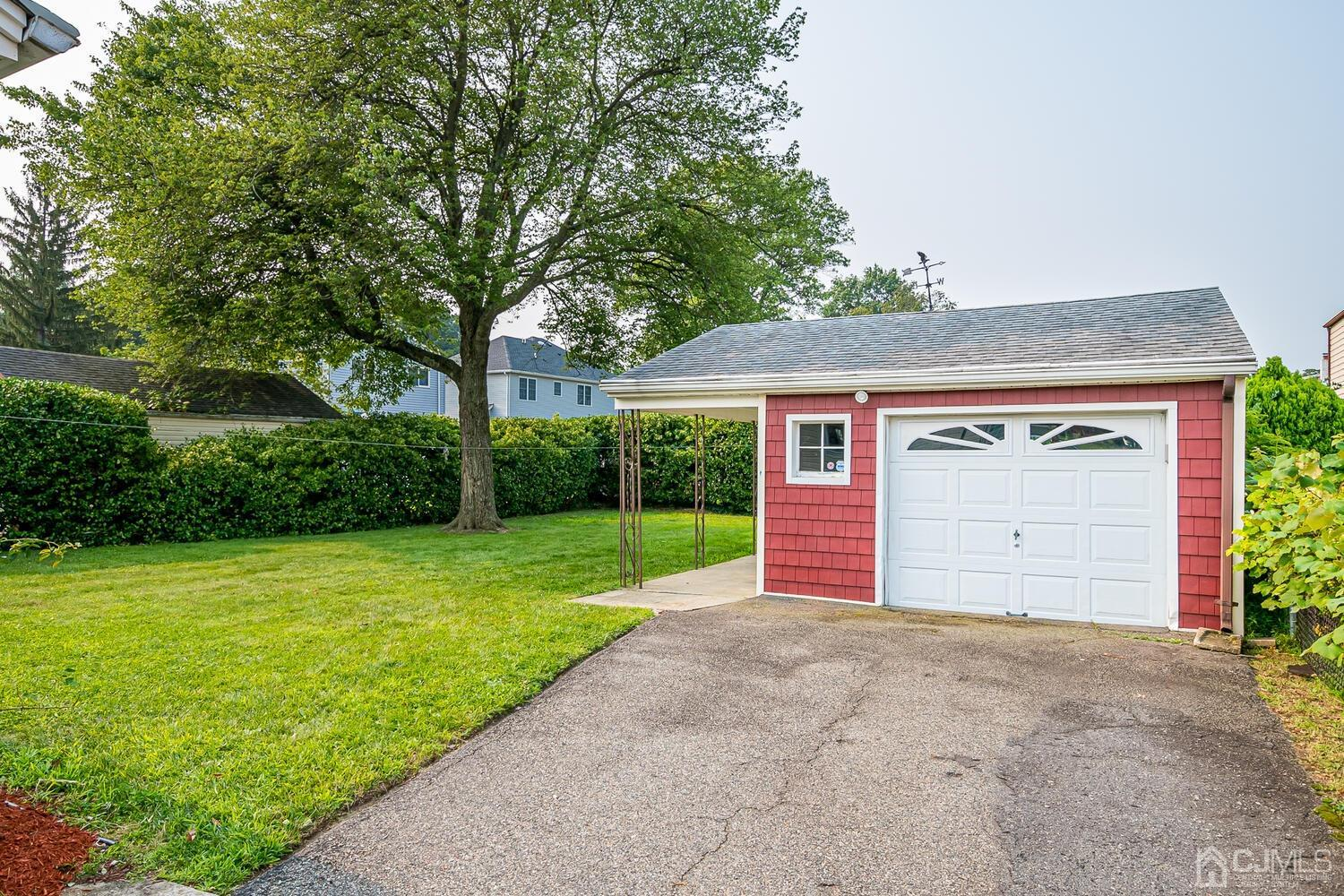 Beautiful Manicured Yard, Offers Total Privacy, Detached Garage with side door.