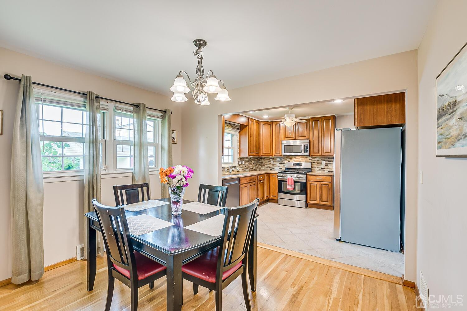 Open Floor Plan from Formal Dining Room to Updated Kitchen with Granite Counter Tops and GorGeous Back Splash.