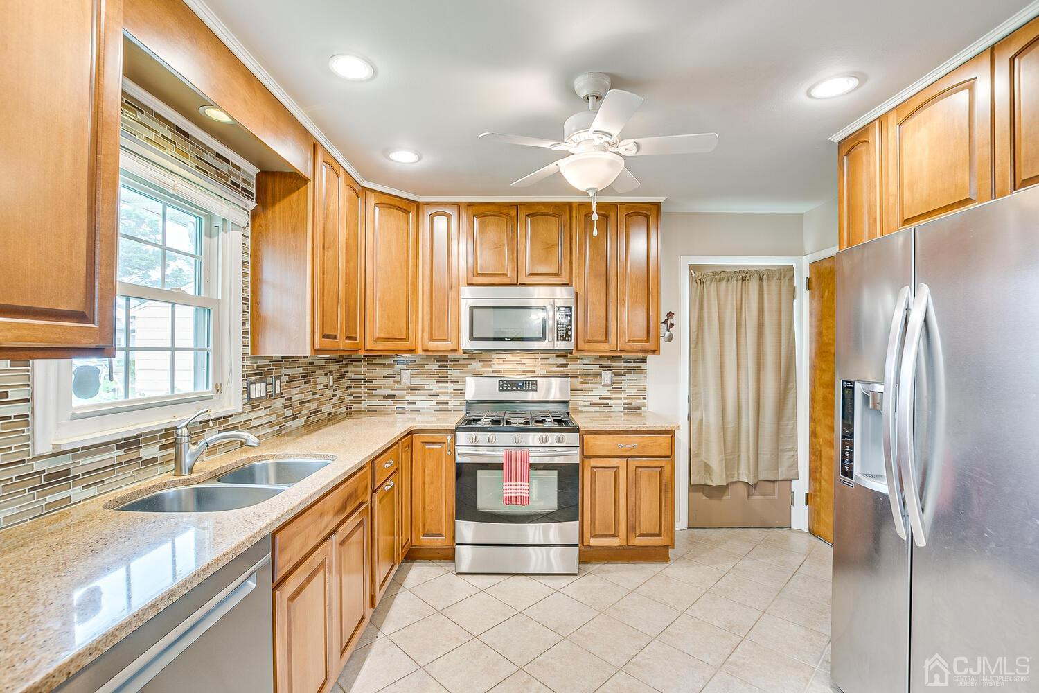 Updated Kitchen, quartz Counters, Beautiful Backsplash, Recessed Lighting and Stainless Steel Appliances.