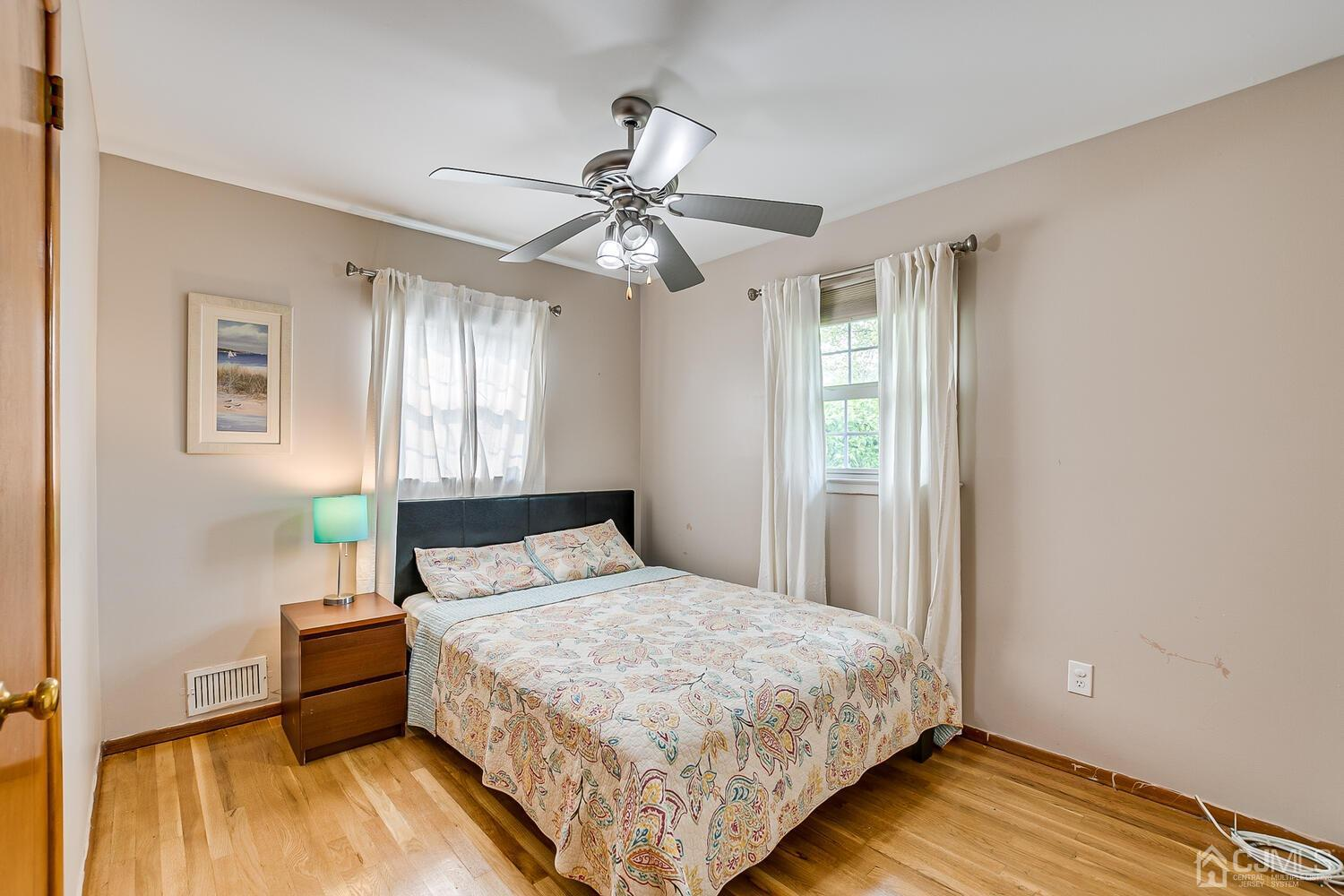 Second Bedroom with Large Closet and Ceiling Fan.