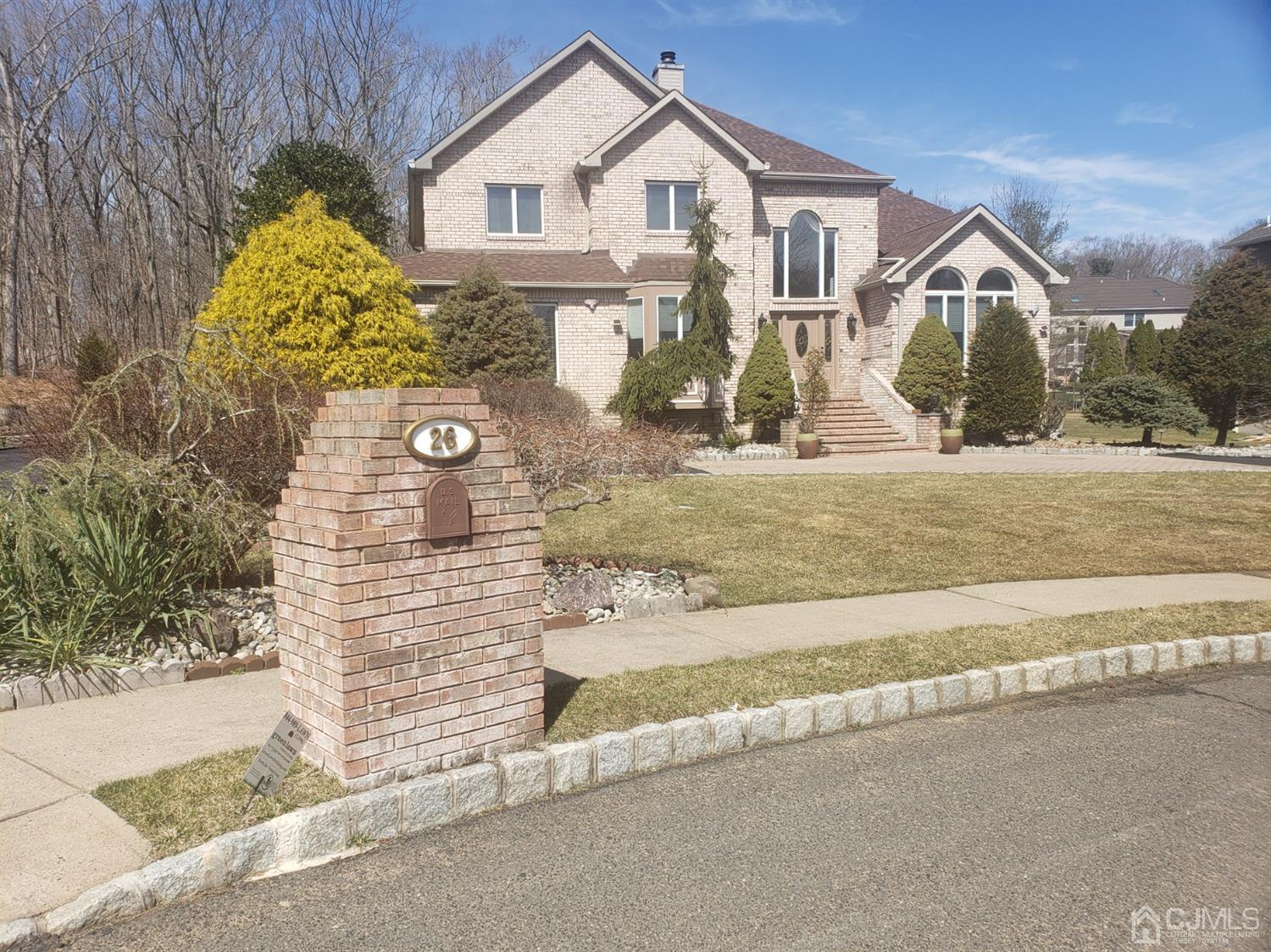 Beautiful brick front colonial on 1/2 acre