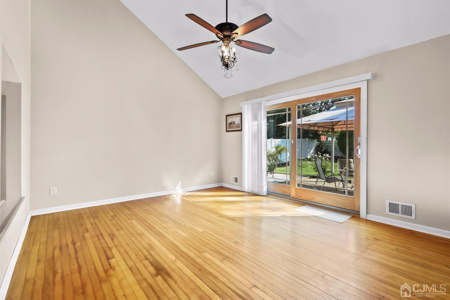 Another view of this gorgeous room with high ceilings and a beautiful slider to the yard