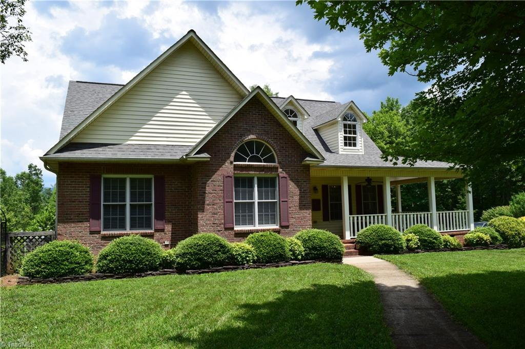 Nestled on 13 acres, this immaculate home gives you all the privacy you want. Mountain views from the covered porch in back and trails that lead to a view of a bold creek. Vaulted ceiling in living area adds spacious feel, hardwood floors gleam, granite counter tops in kitchen and built ins add charm. New heat pump, new fence, fresh paint,  all in 2018. Covered access to Garage and bonus room above garage. Cozy and comfortable! Owner motivated!