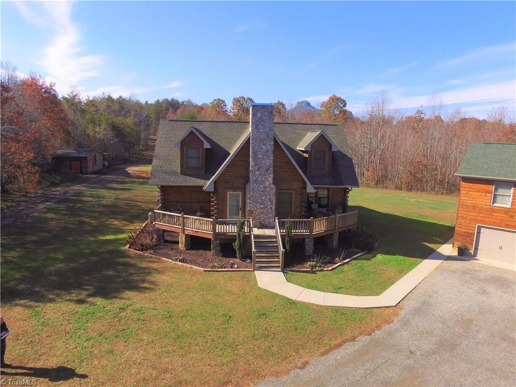 WOW! Log home, matching detached 38x24 garage with 840 sq ft in law suite above garage, on 12 Acres. All of this off road with mountain views! Chalet style log home built in 2007 3br/2.5ba with over 1800 sq ft, front wrap around deck.Home has gas log fire place, Master on the main, hardwoods on main, ceramic tile in bathrooms,Custom counters tops, oak cabinets and the log cabin ambience. In law suite is it's own house, heat pump, 1 br, 1 ba, open kitchen to dining and living room and 180 degree views!