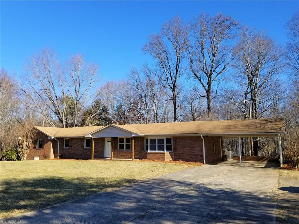 Nicely updated brick ranch on over 8 ACRES. Inside of home is fully updated with New flooring through out including ceramic tile in the kitchen and bathrooms. Kitchen is beautifully updated to an island design open to living room and new stainless appliances! Other updating includes, New paint, New bathrooms, New fixtures, and a New water heater. Home has Large living room, extra large Master, and nicely sized other bedrooms with extra office room, insulated windows, and also an unfinished basement