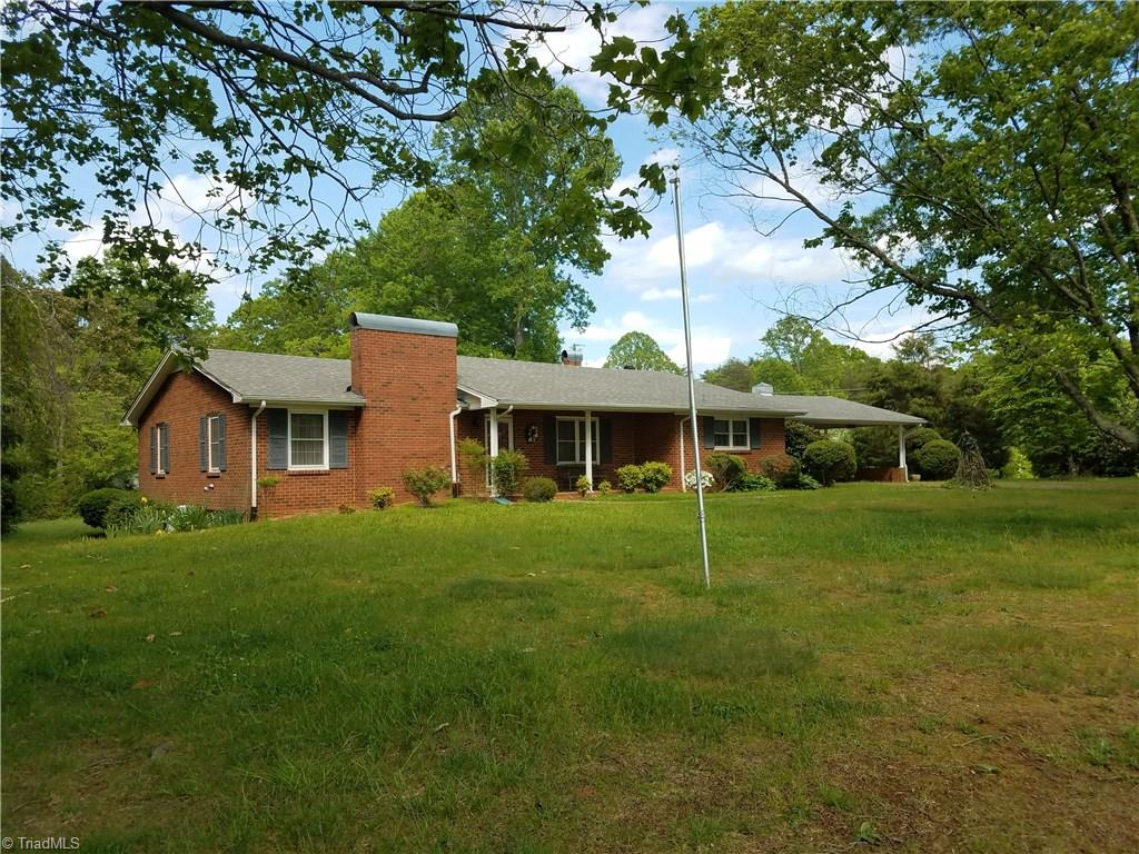 Great brick farmhouse on 47.6 acres. Home has spacious rooms, sunporch, attached carport and full basement with bath. Spacious yard with tool/work shed to keep lawn/gardening equipment. Acreage includes rolling meadows of grass and wooded land with a creek. Great for multi- family or farm!