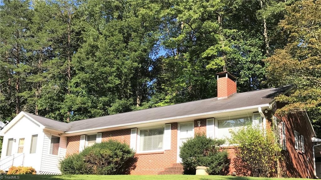 Well kept 3 bed/2 bath brick ranch on over 4 acres in King. Home has been recently painted, hardwood flooring and New Wood laminate in most of the home. All appliances stay including washer and dryer. Home features a heat pump, 2 car carport, storage building, stream on side and front of property, concrete drive, gas logs and privacy on 4 acres! This is the best deal in King for a brick home and acreage outside of a neighborhood. Won't last!