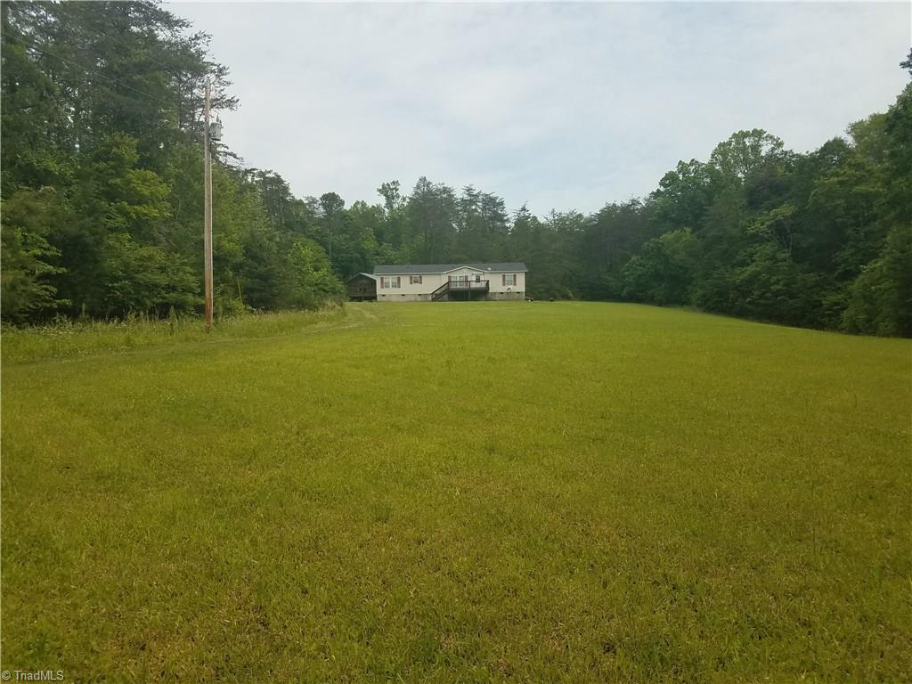 Private and secluded 107 AC property-great for hunting/ getaway-majority wooded, some cleared fields around home and along creek. Bold creek constitutes the western boundary and several creeks cross the property. Lots of wildlife including deer, bear & wild turkeys. Clean and neat home with decks makes a perfect getaway or permanent residence. Driveway is about a mile and a half - easement is recorded. Close to Hanging Rock State Park, Belews Creek, Dan River. No drive-bys, no signs. Appointment only.