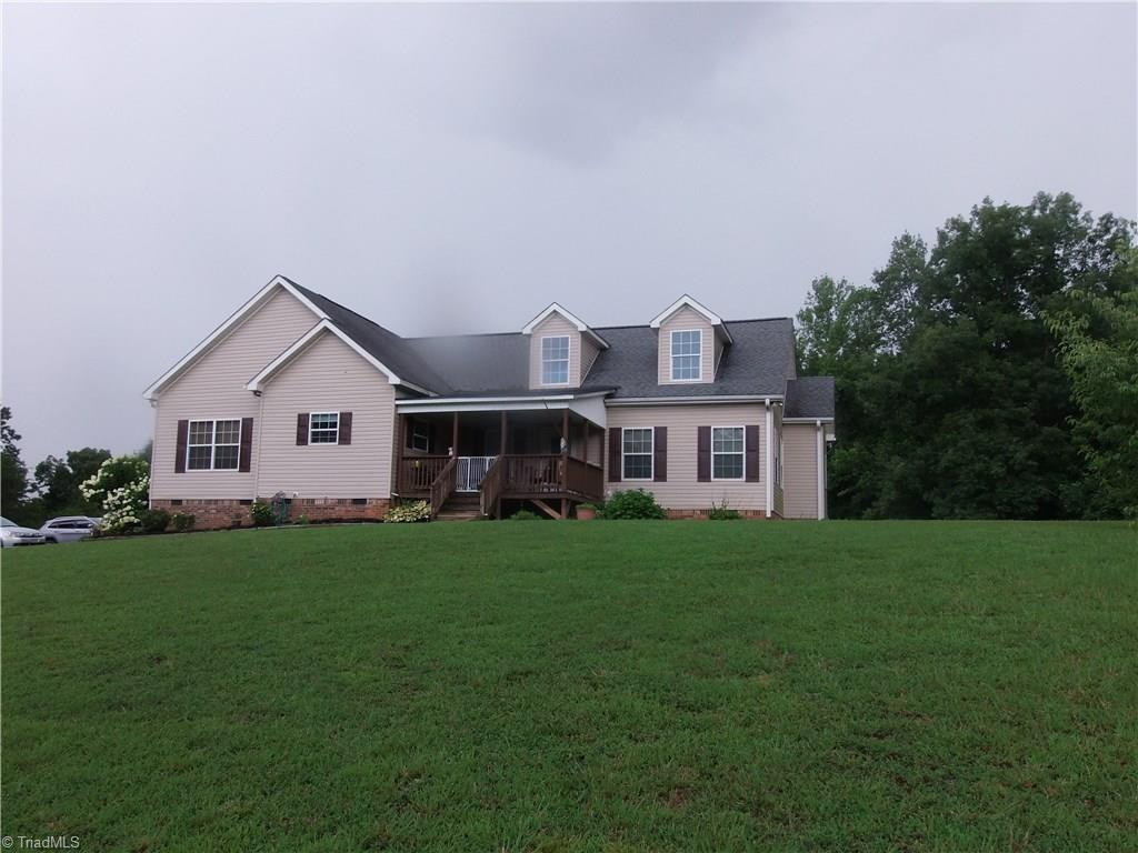 Spacious home sitting on a hill overlooking stocked pond on 11.66 acres. Back property line is the large Double creek. Home has above ground pool (still needs a deck) and one out building.Inside large eat in kitchen with island,  breakfast nook and formal dining. Nice den with fireplace,3 bedrooms/2 bath. Unfinished upstairs can be additional bedrooms, bonus, or storage. Tons of closet space. Take a look today!!!