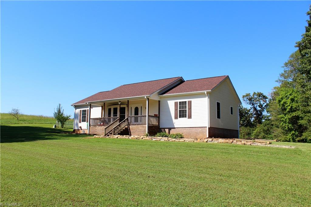 Country living at it's best! 3 bed/2 bath on one acre with basement built in 2004. Home has been well kept, has new roof in 2017, updated 2nd bath, split floor plan, large kitchen and nicely sized bedrooms.  The basement has been beautifully finished for a den or family room for the kids, also has stubbed out plumbing for full bath. Yet there is still plenty of room unfinished for storage. Great area and a quiet place to raise the family!