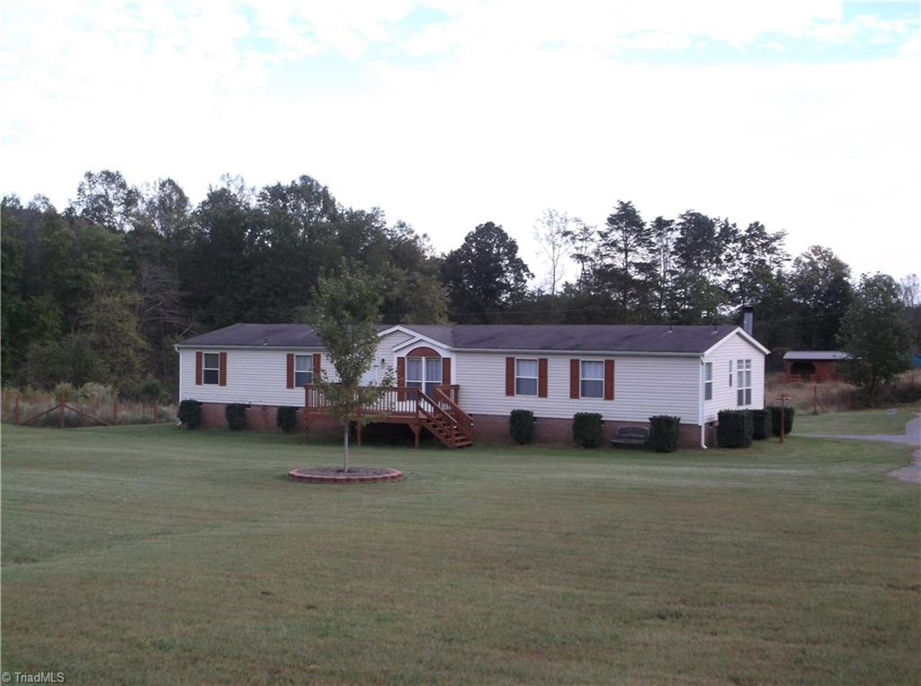 Beautiful home sitting on almost 5 acres! 3BR/3BA w/ bon rm that could be used as 4th BR,lg eat-in kit w/lots of cabs and lg pantry,sep dining area,great rm w/rockfplace,sep living room,huge mstr suite,mstr bath has garden tub&sep shower,nice size laundry room,washer/dryer stays,additional BR's are also nice size,BR3 and the bonus room share a jack & jill bath, front deck & covered back deck for entertaining, fenced spot for garden areas, fenced for pasture & has two barns, pretty landscaping, A must see!