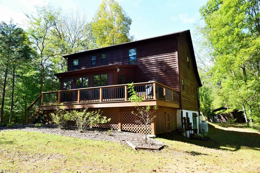 Private retreat surrounded by nature- updated cedar sided home with gorgeous Pella windows to enjoy the views. Carefully and lovingly maintained - ask for supplemental sheet. Spacious back deck overlooking a garden space with room for a firepit - enjoy mountain views in the winter.  Detached 2 car garage and workshop space in the basement. Craft room on the upper floor with built in cabinets and natural light. Small pond is shared with a neighbor.  Immaculate - everything is ready for the next owners.