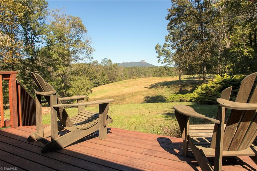 This one has it all! Over 36 acres with a beautiful home and land out in the country with a perfect view of Pilot Mountain! Property also boasts a large horse barn, bold stream and lots of cleared land to roam. This is a wonderful property for anyone that is looking for room for animals or land to build an extra home or just the perfect place to relax and enjoy the sunsets looking at the views! The home is 3 br/2 ba with plenty of room for the family, it is very nicely kept and needs nothing.