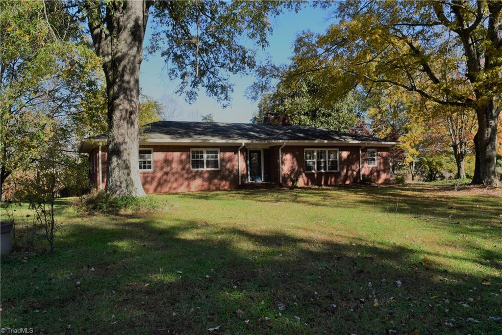 """Country living on acreage in classic brick home with spacious living areas, large deck with covered / uncovered area, updated kitchen and baths, full basement with walk out and detached storage building. Property selling """"AS IS""""; owner is being transferred."""