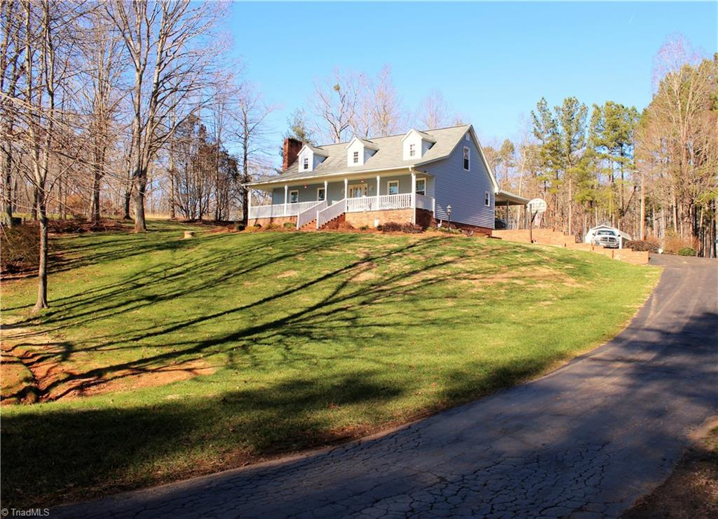 Absolutely beautiful cape cod with picturesque views of Pilot Mountain on over 7 acres.LOTS of finished sq footage for entertaining or those family get togethers, also a New patio out back for those cookouts, a gorgeous in ground pool with wrought iron fencing and pool house/storage building.New insulated windows 2018,New heat pump on the main in 2018,New roof 2018 and New carpet in master. Basement could be inlaw suite. All of this off of the road, has 3 bay equipment shelter and your very own gun range!