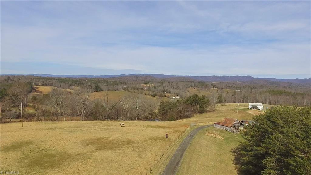 Established 50 acre farm at the end of the road with great views! Has lots of fencing used currently for horses, old farmhouse, horse barn and other barns for storage. Property also has a pond on the front part and a stream on the back of the land. There is about 16 acres cleared and the rest has a good stand of hardwoods. The farm has many possibilities, you could redo the current house or build your dream home while you live in the existing home. Priced to sell! !