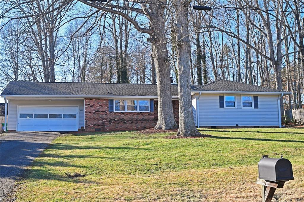 All you need is the moving truck! Recently updated 3br/2ba home in established neighborhood with 2 car garage. Home has new laminate flooring throughout, tile flooring in bathrooms, white washed brick fireplace, and new paint. Roof was replaced in 2011 and heat pump in 2013, home has insulated windows and doors, and fenced back yard with brick patio for entertaining. Beautiful home in a great location! 1 year Home warranty included. Owner NC Real estate agent
