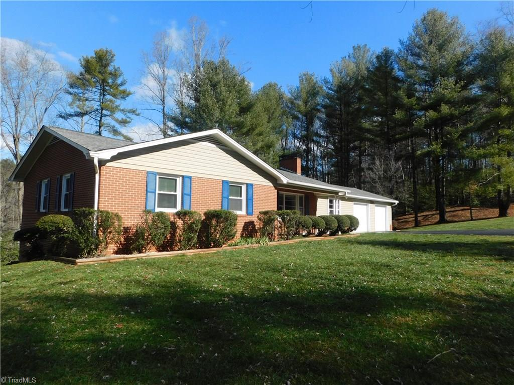 Well maintained brick home on 2.02 acres with creek in back. Paved drive, reseeded yard, 2 outbuildings Both12 X 16 and wired  Over sized 2 car garage. Nice deck Full basement with large workbench area. Home has large den with gas logs. Formal living room or could be Formal dining. Hardwoods under carpet in all bedrooms ,hall. and living room. remodeled kitchen with oak cabinets. Bathroom has double sink vanity. Come take a look.
