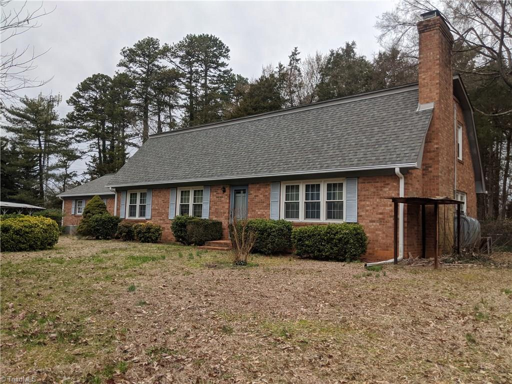 Older home located on 2.96 acres. The home is located very near shopping and schools.  The property has been surveyed into 4 tracts, but is being sold as a whole.  Ideal for a mini farm or single family development.  Storage buildings and sheds located on the property.