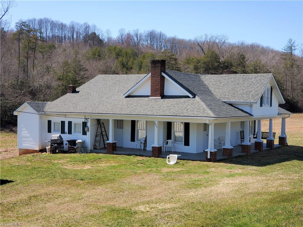 An Absolutely beautiful old style farm complete with large barn. Almost 40 acres with farm house and barn, mostly cleared land with a bold creek going through the middle.  Heat for home is a monitor heater. Land has multiple home sights with wonderful views of the Blue Ridge Mountains. Home is in great condition for the age and has all the character of a time gone by. A one of a kind gem in the heart of Surry County. See attached drone video. 