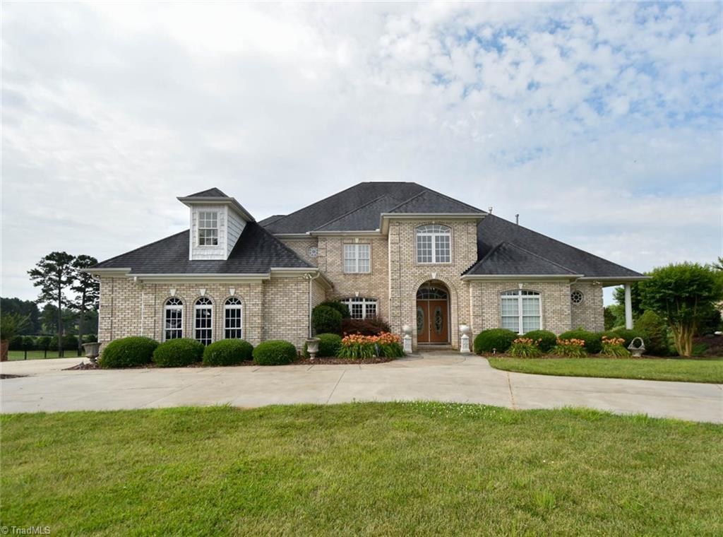 Reduced $20,000  Overlooking the 18th fairway green/lake/clubhouse, Beautiful landscaping, 3 car garage w/circle drive. Double doors to the two story foyer & living room. Wood flooring through out most of area, tiled bathrooms, Master bathroom has tile surround shower & jetted tub, his/hers walk-in closets w/built-in shelving and Curved Balcony open to below. Two stair cases. Kitchen has granite countertop, gas stove with grill.  Entertainment for covered porch and  new deck. Sprinkler system.