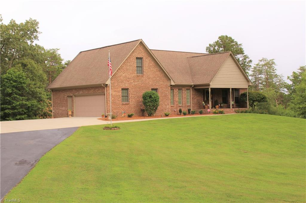 BACK ON THE MARKET AT NO FAULT TO SELLER!! Immaculate custom home on over 12 acres with privacy! Covered deck on back with ceiling fan. Patio on lower level, 16x40. Out building with water, electricity and wood stove that is 24x36 with a loft. Dog lot that is 4800 sq. ft. Lancaster water softener system. Den has Yamaha RX-A660 7.2 surround sound with Klipsch speakers and subs. Volt Lighting landscape lights. Many features inside too numerous to list. Private and quiet dead end road. Escape the city and come relax on your own 12 acre estate!