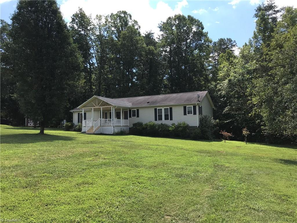 Horse lovers dream and a rare find! 3BR/2BA home sitting on +/- 15.63 acres, country setting yet very convenient to amenities, house is very spacious with lots of room inside and out for entertaining, lg kitchen and dining area, huge living room with wood burning fireplace, covered front porch, lg back deck, storage building, 3 pasture areas, 4 stall wired barn with water, tack room and hay loft, chicken coop, dressing ring, stream on property, 18 x 30 wired workshop with water, fruit trees and bushes