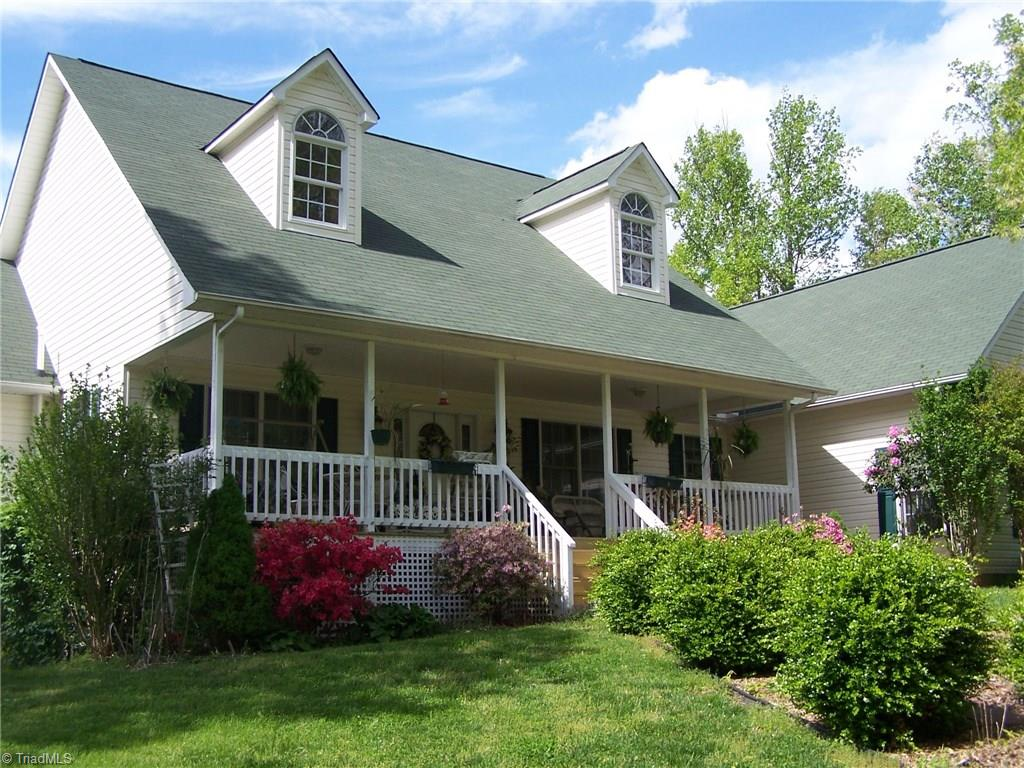 Beautiful secluded home on 37+ acres. 4 bedrooms, 3 baths. Custom eat in kitchen with hickory cabinets. Hardwood and tile floors. LR vaulted ceiling. Master with jetted tub, shower, double sinks. ML laundry w/d stay. Basement den, wood stove, 4th bedroom (septic for 3) and bath. Covered front porch and back screened porch. 3000' on bold Big Creek. Land for pastures, hay gardening, crops or hunting or walking. Abundant deer and turkey. Two tracts for multi family living. Grapes pears and blueberries.