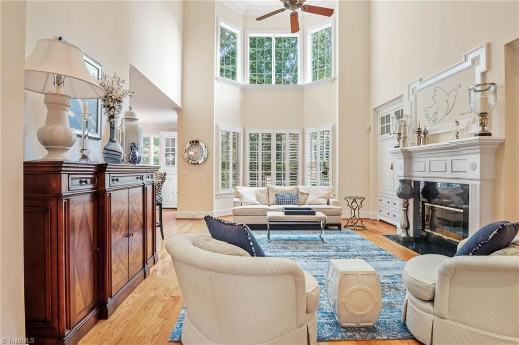 Stunning Home in Greenbrier Farm! 2 story LR w/ wall of windows, FP & built-ins. Kitchen w/ dbl oven, gas stove, granite counter tops, bar, & open shelving. Breakfast nook w/ access to large private back deck. Sep. DR & Den both w/coffered ceilings & plantation shutters throughout. Office off of K. Large MB w/ tray ceilings & private screened deck. MBTH has sep shower, jetted tub & huge walk-in closet w/ W/D connect & steamer. 3 add. BR w/BTH on 2nd. Fin. Basement has Movie Room, Den w/ FP, add. BR & Gym.
