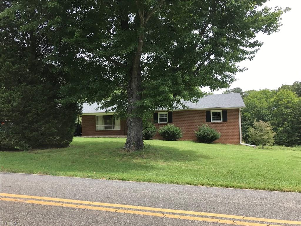 Back on market due to no fault of seller, Cute brick ranch on 2.482 acres per recent survey, great location with Sauratown Mountain views, 3BR/1,5BA, large kitchen/dining areas, mstr bedroom has 1/2 bath in it, lots of charm in this home, windows have been updated, covered front porch, deck, attached carport, full basement for further expansion, being sold as is, 3 adjoining lots are also for sale