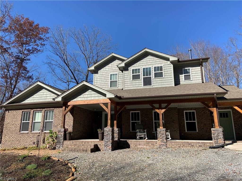 Beautiful custom home on secluded 10.21 acres. Home features 3BR, 2.5 BA 2950 sq ft plus a garage apt 960 sq ft with 1BR/1.5BA. Great room with farmhouse charm. Eat in kitchen, quartz and marble , farmhouse sink, pantry w/ barn door. Family room offers a cultured stone FP and cedar mantle heated natural gas. Dining area for large table that opens to screened back porch. ML master suite double closets, double sinks and freestanding tub. ML also offers laundry, play room or office and half bath. UL offers 2 bedrooms, bonus room and bath. Walk out basement waiting to be finished with craft room, wood stove, gym and 18X30 storage/man cave. Cozy garage apartment features ML living/ kitchen combo with half bath & w/d hookups. UL bedroom, bath office and den. Meadow with fruit trees and path that leads to Grassy Creek and Big Elkin Creek meet and you have sandy beach. Views Elkin Creek Vineyard. Things that do not convey: blinds and refrigerator in apt, rv carport and stor bld