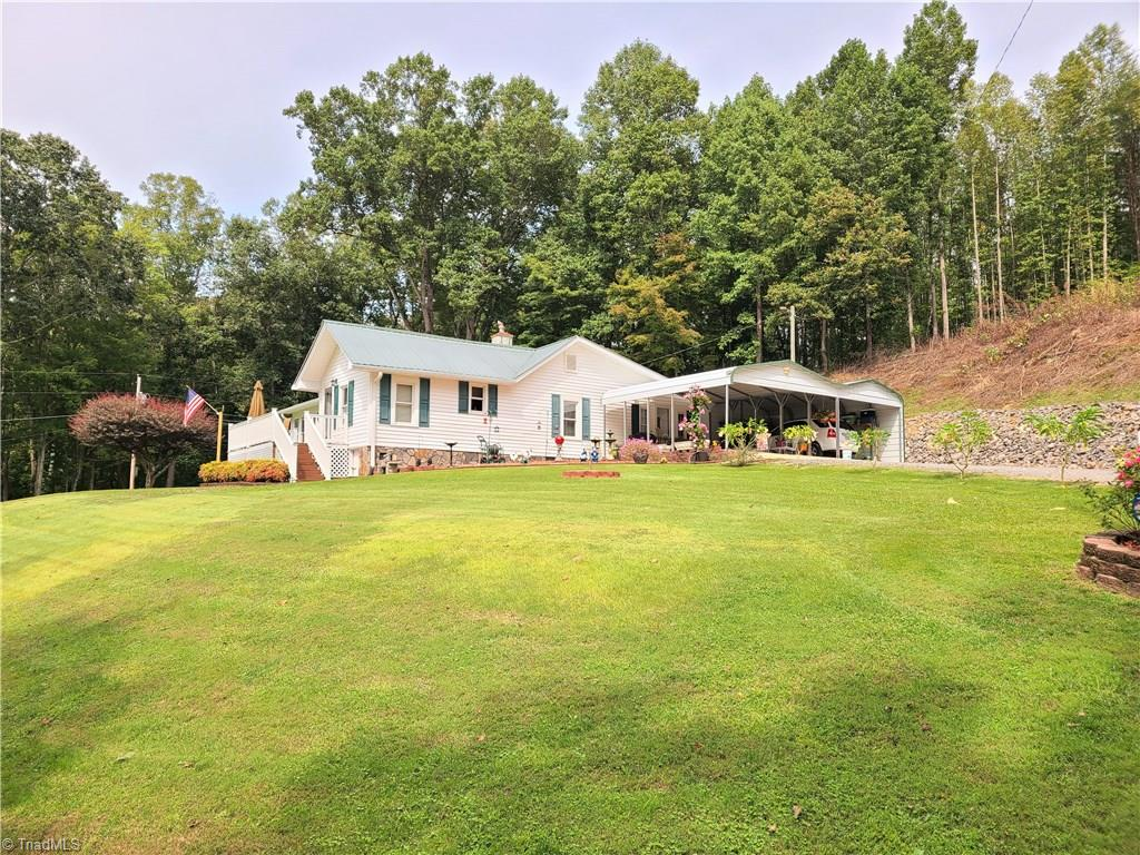 Completely updated farm house on 28 acres!  This one has a little bit of everything, cleared land for the animals, a creek on the property, different buildings, and a beautiful home move in ready! The home has been completely updated with hardwood and tile flooring, insulated windows, heat pump, baked tin roof, bathrooms updated, large living areas, and updated kitchen appliances. Property boasts 8 to 10 acres cleared perfect for animals or an additional home site. This is a must see farm property with a great condition home.